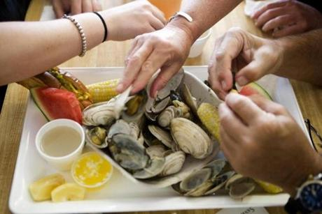 METRO- Patrons eats clams at Woodman's in in Essex on Thursday July 27, 2012. Photographed for the Roads of Summer Series. (Laurie Swope)
