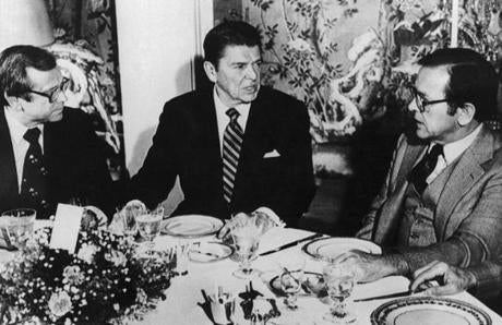 President-elect Ronald Reagan (center) spoke with Senator Howard Baker (left) and Senator Ted Stevens during a luncheon.
