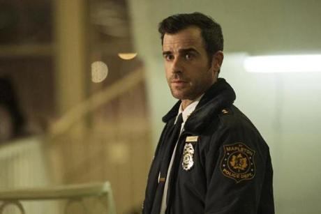"Justin Theroux (above) stars as police chief Kevin Garvey in HBO's ""The Leftovers."""