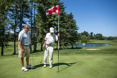 Club members John Viall (left) and Emmett Clemente played the 18th hole.
