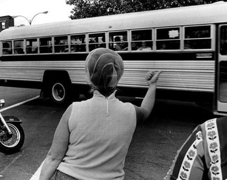 A woman at the corner of Old Colony Avenue and Dorchester Street shouted at students who were being bused home to Roxbury in 1974.