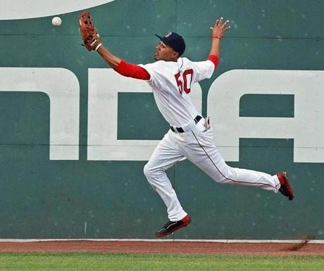 Red Sox rookie Mookie Betts lunged for the ball after it hit off the wall in center field at Fenway Park, giving the Cubs' Nate Schierholtz a second-inning double in Fenway Park.