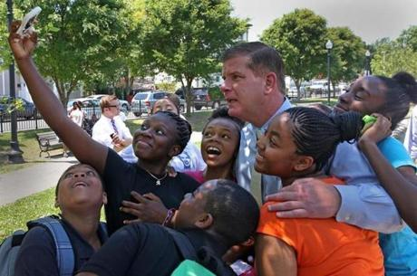Ryan Perry took a group selfie with Mayor Martin Walsh and friends at Dennis Street Park in Roxbury.
