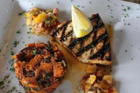 The Voodoo Swordfish comes with sweet potato and poblano pepper hash.