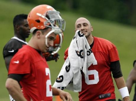 Brian Hoyer, right, will try to hold off rookie Johnny Manziel, left, in the Browns' quarterback competition.
