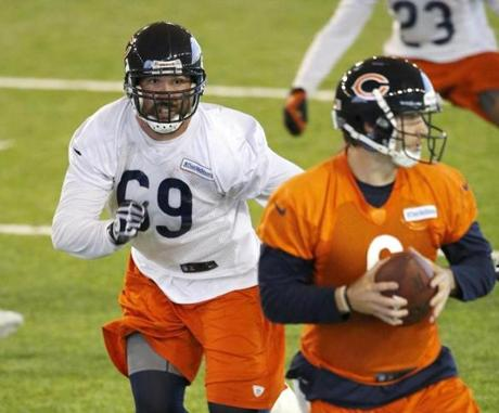 The Bears are counting on new faces like Jared Allen, left, to bring new life to their defense.
