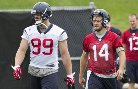 While J.J. Watt, left, will lead the Texans defense, it will be Ryan Fitzpatrick leading the Houston offense to start the season.