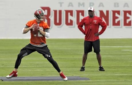 New coach Lovie Smith, right, tabbed Josh McCown as Tampa's starting quarterback already.