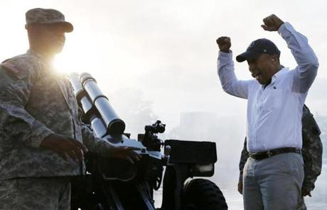 Governor Patrick reacted after firing a cannon before the concert.