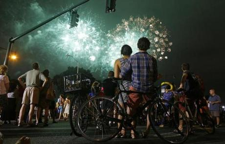 From Massachusetts Avenue in Cambridge, Katie Tong and Ben Morrow watched the fireworks over the Charles River.