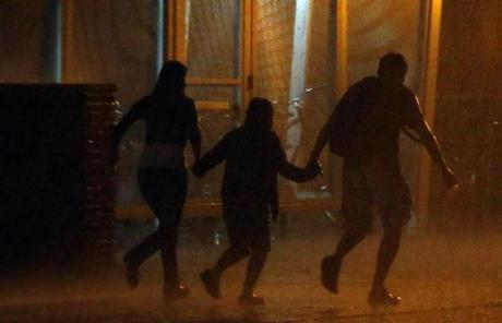 People ran through a downpour in Cambridge after the fireworks display.