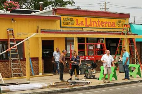 "A pizza restaurant was made over into a Cuban cafe on Revere Beach Blvd. across the street from Revere Beach on July 8. The area is being transformed into Miami Beach for a scene from the movie ""Black Mass."""
