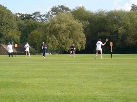The players in white are playing for England Ladies, and the blues are the Stoolball England President's XI.