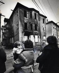 The burned-out Lowell house where eight people died.