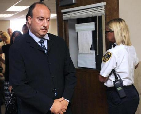 John Rogaris, owner of Roggie's Brew and Grille, left the courtroom after pleading not guilty to charges that hemisled Boston police.