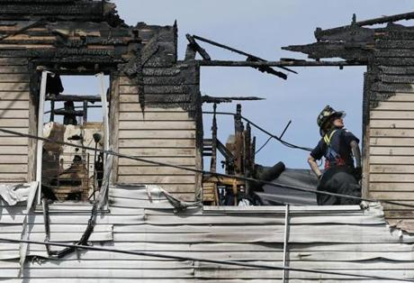 A firefighter worked on the top floor of the building after the fire.