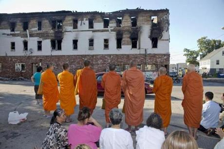 Buddhist monks chanted in front of the building with hundreds of people from the Cambodian community gathered at the scene.