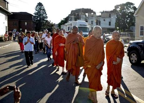 Monks from Glory Buddhist Temple led people from the scene of a deadly fire in Lowell.