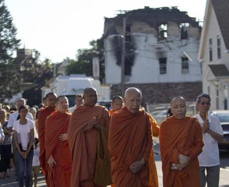 Monks from Glory Buddhist Temple led people away from the building Thursday.
