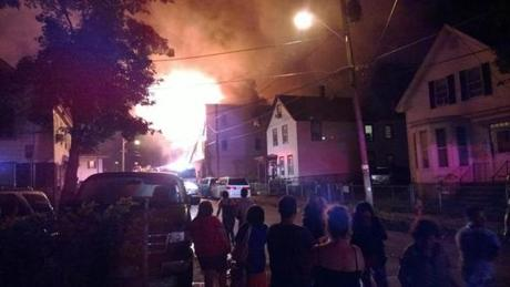 Bystanders watched the fire, which broke out when many were sleeping.