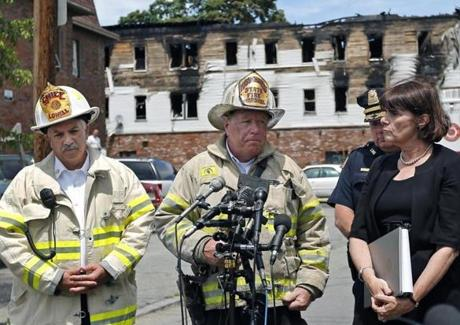 Lowell Fire Chief Edward Pitta (left) Mass. State Fire Marshal Stephen Coan, and Middlesex County District Attorney Marian Ryan held a news conference.