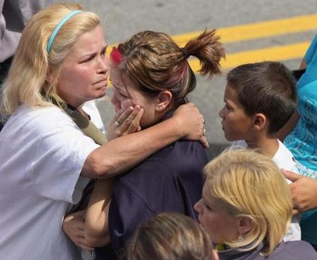 Loved ones consoled each other after the fatal three-alarm fire.