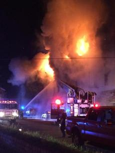 Firefighters used a hose to battle the blaze.
