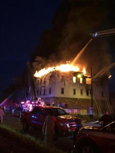 The fire engulfed much of the building's upper floor.