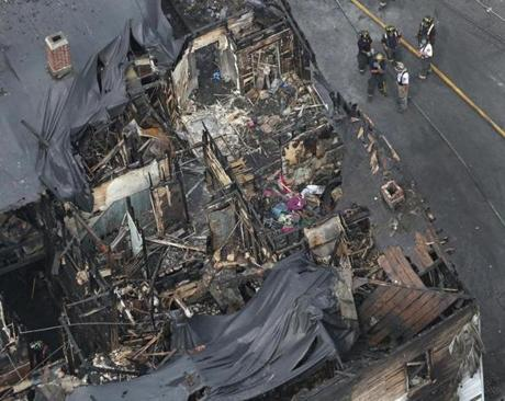 An aerial view of the scene of a deadly fire in Lowell.