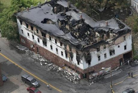 An overhead view shows the damage to the upper part of the building.