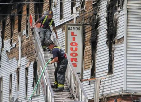 Firefighters continued to work on the building hours after the blaze.