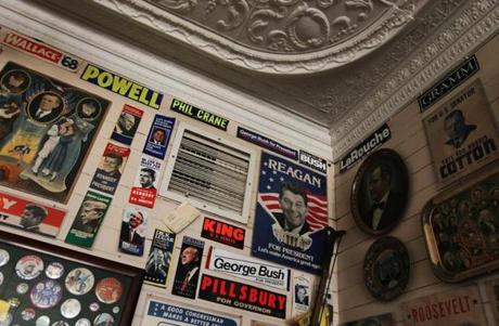 A tin ceiling frames years of political posters and bumper stickers on the walls of Robie's Country Store.