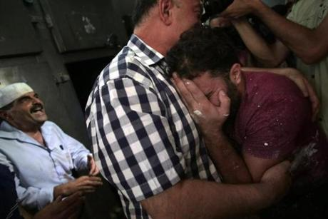 Palestinians mourned their relative in the morgue of Shifa Hospital in Gaza City.