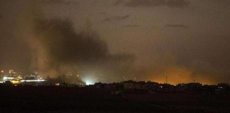 Smoke billowed from buildings after an Israeli airstrike in Gaza City.