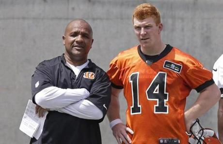 New offensive coordinator Hue Jackson  is tasked with improving Andy Dalton's game.