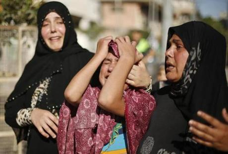 People mourned the dead children at their funeral in Gaza City.