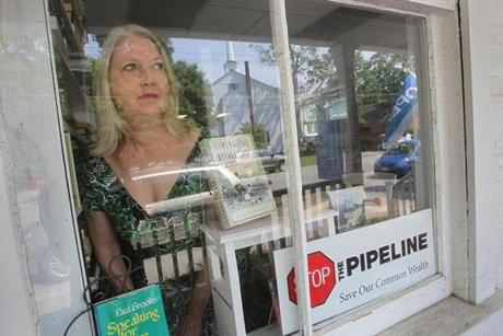 opposition to the gas pipeline. After Dawson joined the Stop the Pipeline Coordinating Committee in Groton, her shop, Second Hand Prose Books, became a distribution point for yard signs, bumper stickers and information.