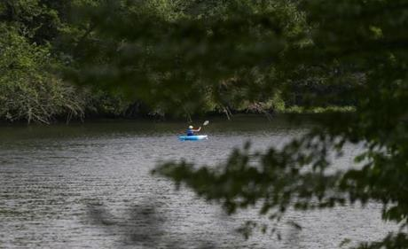A Kayaker navigates the Nashua River in Pepperell . Residents are against a high pressure gas pipeline that would run under a portion of the river. Supporters say the new gas supply is badly needed to keep heating and electricity costs down in New England.