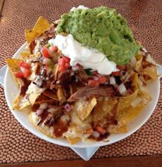 BBQ nachosThe Farm Bar and Grille, 233 Western Ave., EssexTortillas are hand cut and fried into golden chips, then layered with Vermont cheddar cheese; 12-hour-smoked pulled pork; generous helpings of pico de gallo and guacamole (both homemade); sour cream; and barbecue sauce. $7 for small and $10 for large.www.farmbargrille.com.