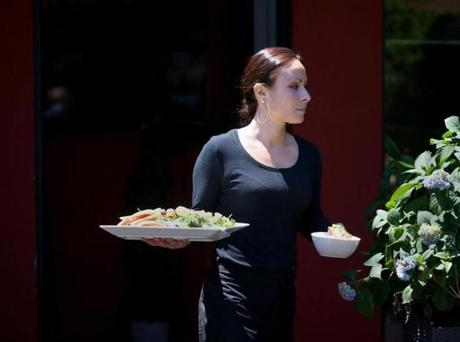 Danielle Fitzgerald brings out her customers' orders at Spiga.