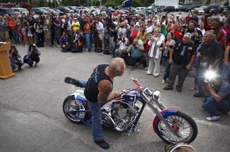 Paul Teutul, the founder of Orange County Choppers, rolled in the bike.