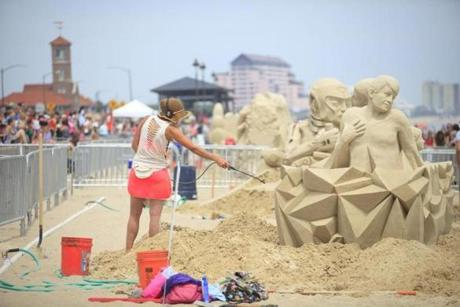 Thousands gathered to watch the artists finish their sculptures.