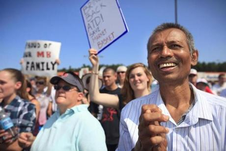 Yogesh Patel of Billerica, a janitor at store 170 in Billerica, cheered at a rally in support of former Market Basket CEO Arthur T. Demoulas.