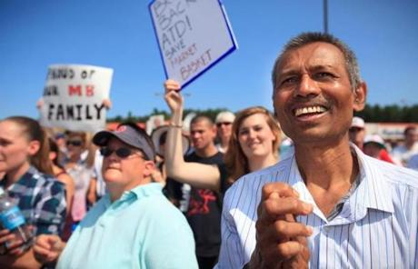 Yogesh Patel, a janitor at store 170 in Billerica, was among those at the protest.