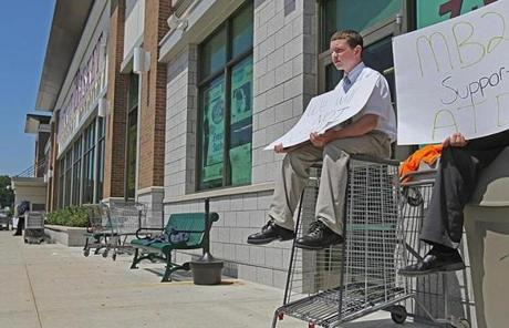 Matthew Dirico sat outside the Market Basket store in Burlington.