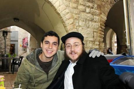 Nissim Sean Carmeli (left) posed with Rabbi Asher Hecht in Jerusalem.