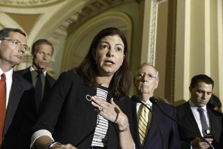 Senator Kelly Ayotte spoke to reporters about competing bills from the Democrats and Republicans on employee health coverage and birth control under the Affordable Care Act.