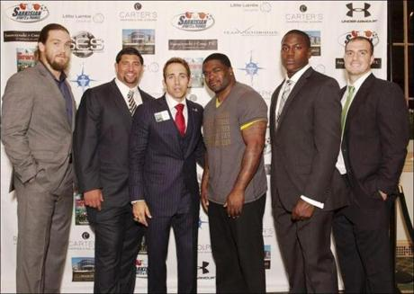NFL players (from left) Bryan Braman, Joe Vellano, agent and author Sean Stellato, Patrick Pass, Marcus Whitfield, and Andrew DePaola at Stellato's book release party.