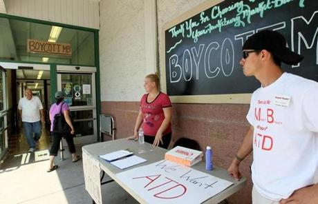 On Tuesday, protesters set up outside of a Market Basket in Lowell.