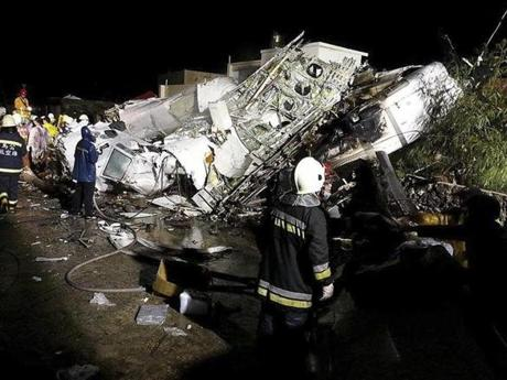 Rescue personnel surveyed the wreckage of TransAsia Airways flight GE222 on Taiwan's offshore island of Penghu on Wednesday.